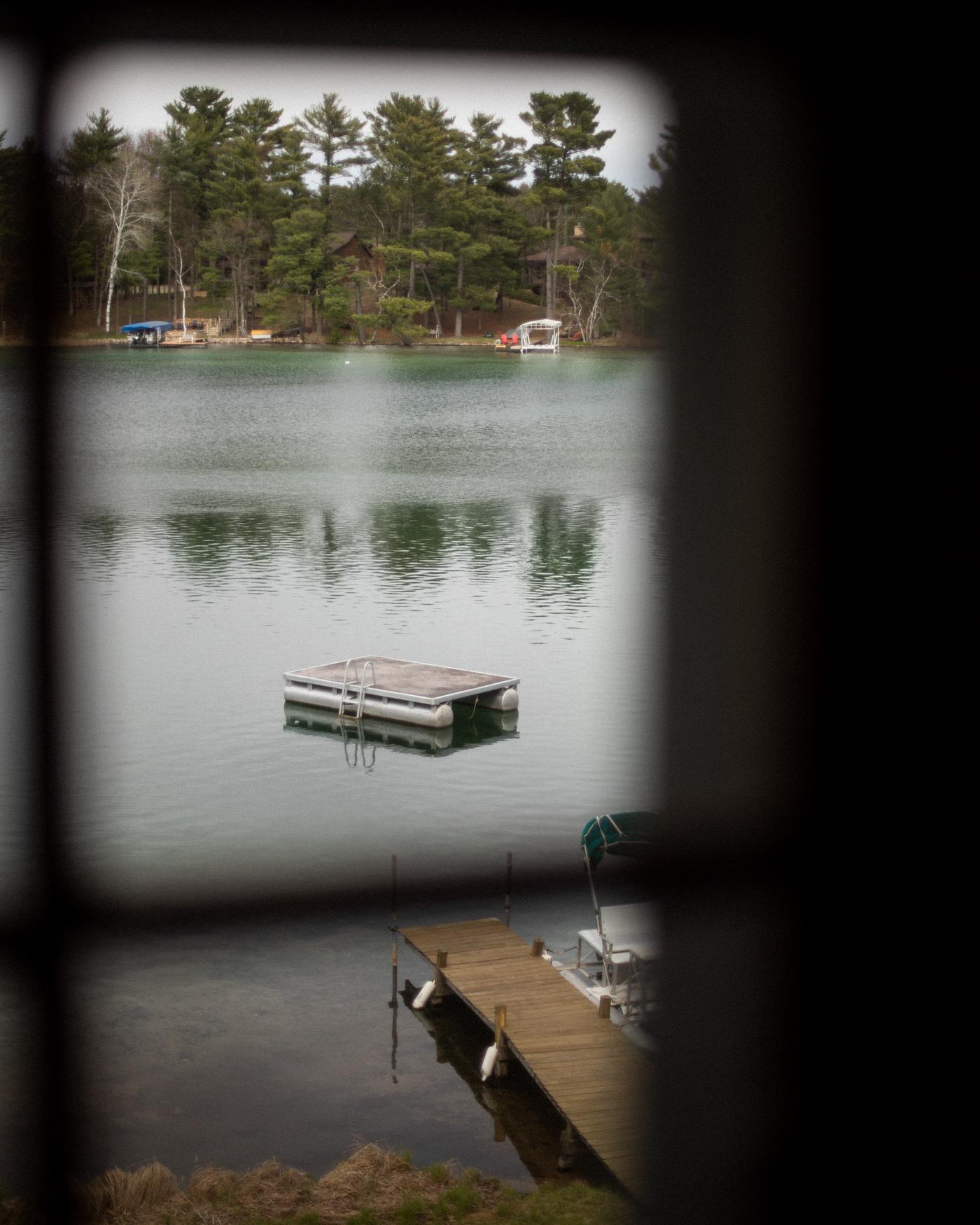Image may contain: water, lake and boat