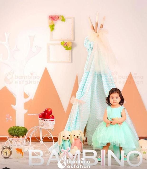 Image may contain: wall, dress and baby