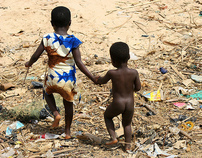 Holding hands in the slums of Accra, Ghana.