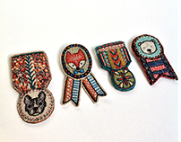 Embroidered medal brooches