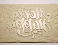 lettering-linocut-merry happy